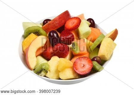 A bowl of fresh cut mixed fruits. Isolated on white fruit includes, Strawberry, Pineapple, Apple, Cantaloupe, Honeydew Melon, Kiwi and Grapes.