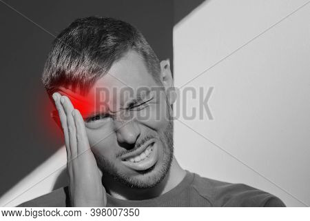 Young Man Touching His Temple And Having Strong Tension Headache. Cluster Headache. Man Suffering Fr