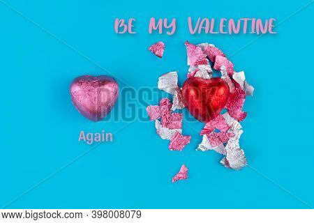Concept Of February 14 Or Valentines Day. Chocolate Candy-a Heart In A Red Wrapper And A Torn Wrappe