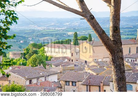 View Of The Historic Town Of San Gimignano With Tuscan Countryside On A Sunny Day In Summer, Tuscany