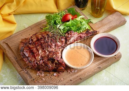 Medium Ribeye Steak With On The Wooden Tray. Steak Beef. Beef Steak Medium Withwith Mix Salad.