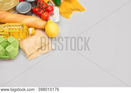 Flat Lay Composition With Food Donations On Grey Background With Copyspace - Pasta, Fresh Vegatables