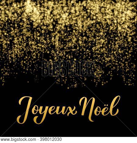 Joyeux Noel Calligraphy Hand Lettering On Shiny Gold Sparkles Background. Merry Christmas Typography