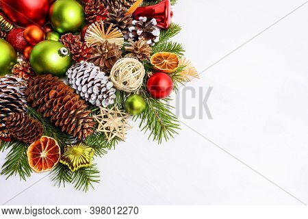 Christmas Decoration With Spruce Cones, Red Balls And Green Ornaments