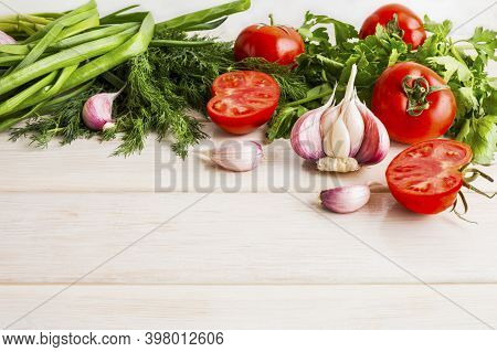 Garlic Tomato And Herb On The White Wooden Background. Vegetarian  Vegan Food. Healthy Eating Concep