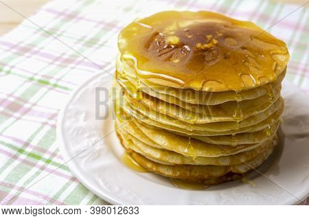 Homemade Of Breakfast Pancakes With Honey On The White Plate. Homemade Pancakes Served For Breakfast