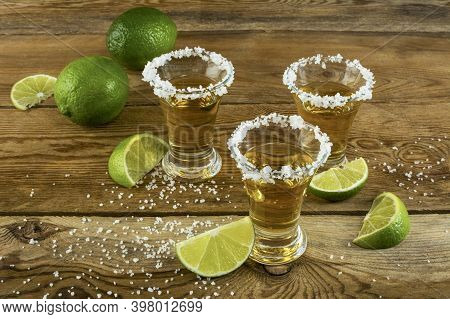 Mexican Tequila Shots With Lime And Salt On The Wooden Background. Gold Mexican Tequila. Tequila Sho