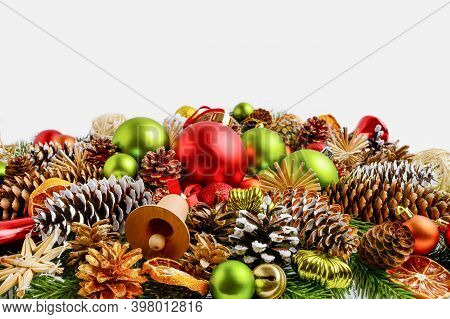 Traditional Christmas Ornaments, Fir Branches And Pine Cones. Christmas Decoration With Baubles And