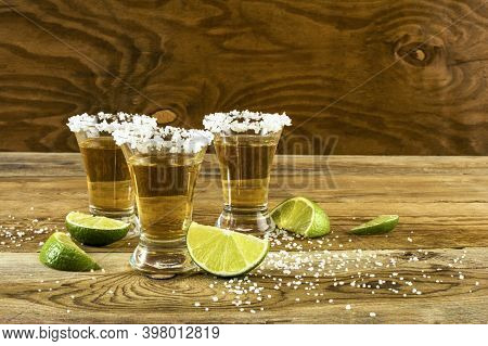 Three Tequila Shots Copy Space. Tequila Shot. Gold Mexican Tequila. Tequila. Alcohol  Drink