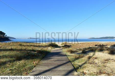 Beach With Wooden Boardwalk At Famous Rias Baixas Region. Muxia, Coruña, Galicia, Spain.