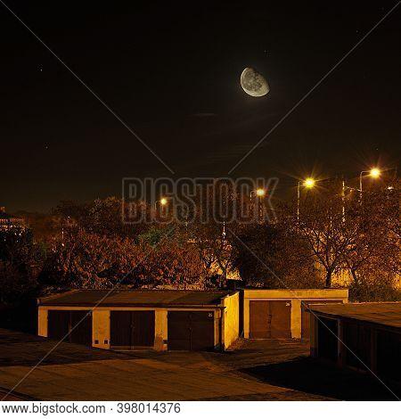 Chomutov, Czech Republic - November 05, 2020: Moon Above Garages In Night - Analog Noise 400 Asa  Te