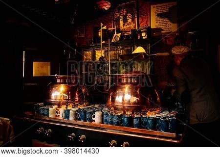 A Medieval Cask Holds Beverages For The Visitors And Clay Cups For Christmas Mulled Wine In Christma