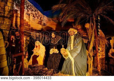 The Three Wise Men And Baby Jesus. The Christmas Tale With A Nativity Scene At Christmas Market In D