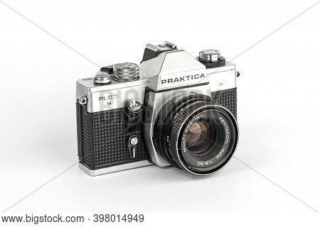 Praktica Plc3 Film Slr Camera With Pentacon Lens. Vintage 35Mm Reflex Camera On White Background.