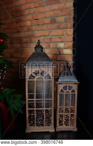 Vintage Brown Lanterns In Home. Christmas Living Room Is Decorated With Lanterns. Wooden Lantern Nea