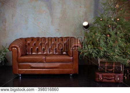 Christmas Room Interior. Stylish Interior Of Living Room With Christmas Fir Tree And Brown Sofa. Bea