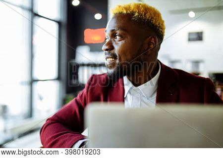 Afro American Man In Marsala Jacket Remote Work In Living Room At Home