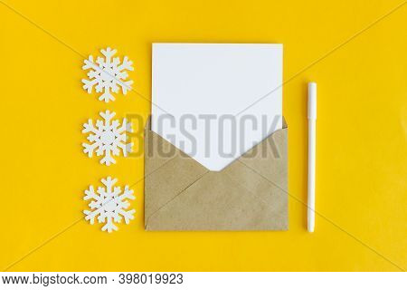 An Envelope With A White Sheet Of Writing Paper. A Festive Composition. A Letter To The Future Or To
