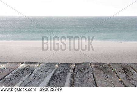 Empty wood table top and blur sea