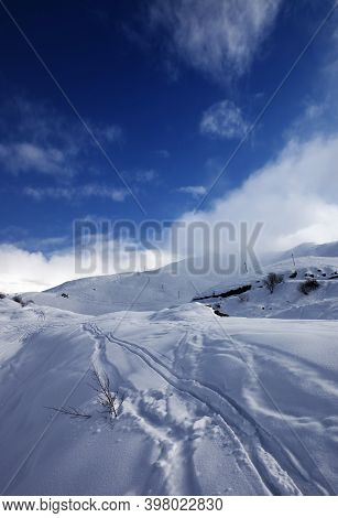 Snowy Off-piste Slope With Trace From Skis And Snowboards In High Winter Mountains At Evening. Cauca