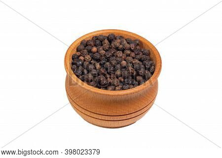 Black Peppercorns In Wooden Bowl Isolated On White