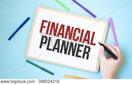 Text Financial Planner On A Notebook Surrounded By Colored Felt-tip Pens, Business Concept Idea,