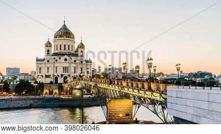 Sunset View Of Cathedral Of Christ The Savior And Moscow River In Moscow Evening. Patriarshy Bridge