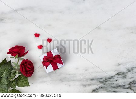 Happy Valentines Day With Lovely Red Rose Flowers Plus Giftbox On Natural Marble Stone Background