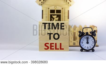 Time To Sell Real Estate. Wooden Blocks Form The Words 'time To Sell' Near Miniature House. Black Al