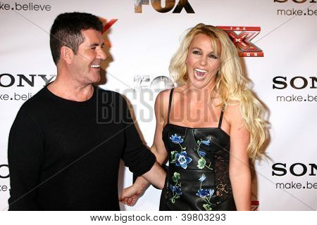 LOS ANGELES - DEC 6:  Simon Cowell, Britney Spears arrives to the X Factor 2012 Final Four Party at Rodeo Drive on December 6, 2012 in Beverly Hills, CA