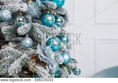 Beautiful Christmas Tree In The Winter Interior Of A Photo Studio, Bedroom, New Year Decoration. Blu
