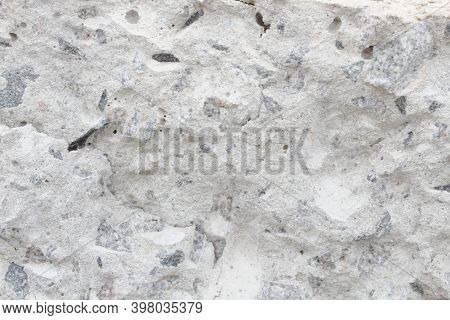 Fragment Of A Destroyed Concrete Wall. Photo Of A Wall Fracture.