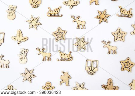 A Texture Formed By Small Wooden Christmas Icons On A White Background
