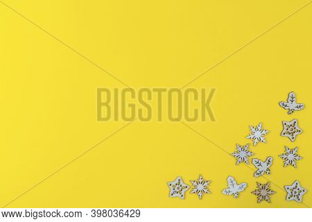 A Texture Formed By Small Wooden Christmas Icons On A Yellow Background