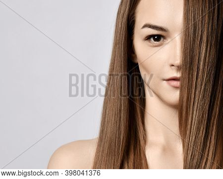 Portrait Of Young Beautiful Woman With Silky Long Straight Hair And Hazel Eyes Looking At Camera Ove