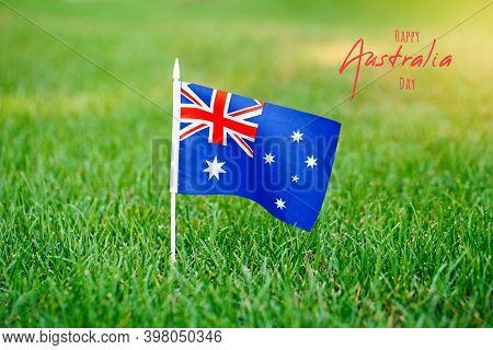 Australia Day Card With Text. Australian Flag Standing On Green Grass. Australia Day National Holida