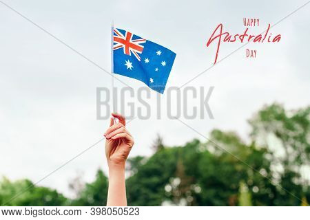 Happy Australia Day Card With Greeting Text. Closeup Of Woman Human Hand Arm Waving Australian Flag