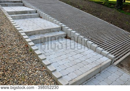 Solution Of Paved Parking Lot Surfaces And Roads With The Ability To Absorb Water Directly From The