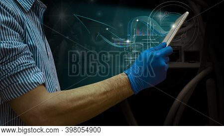 Business Growth Analysis. A Businessman Using A Tablet Analyzes Sales Data And An Economic Growth Gr
