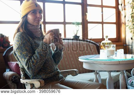 Woman With Tea At Home For Christmas Holidays. Woman Relaxing With Coffee At Home. Winter Lifestyle.