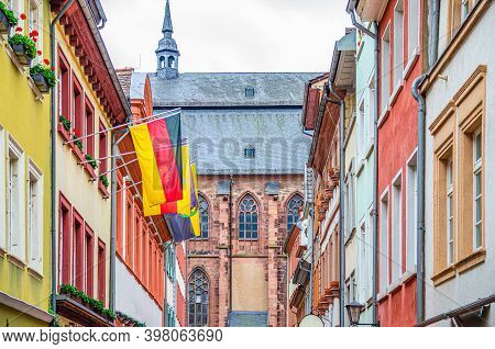 Street With Typical German Houses With Colorful Walls And German Flags And Church Of Holy Spirit Hei