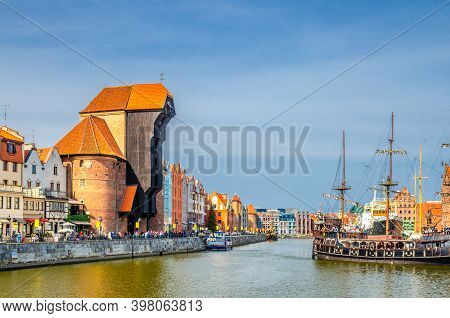 Gdansk Cityscape With Zuraw Crane Building And Typical Colorful Houses At Long Bridge Embankment Pro