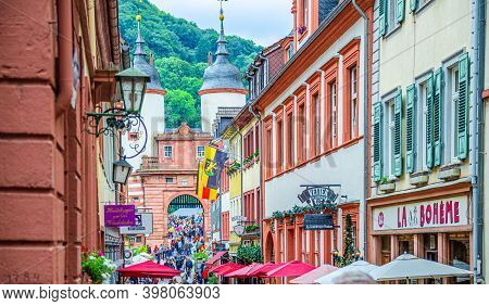 Heidelberg, Germany, August 12, 2017: People Tourists Walking Down Pedestrian Street With Typical Ge