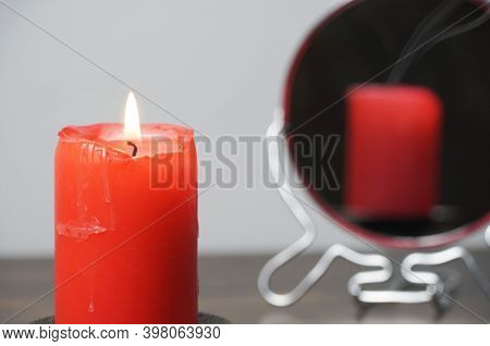 Concept Photo Of A Lighted Candle That Is Not Reflected In The Mirror.christmas Divination And Spiri