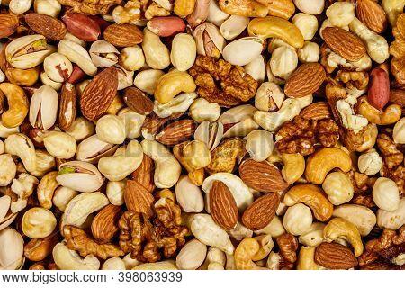 Background Of Mixed Nuts (walnuts, Pistachio, Almond, Peanut, Cashew, Hazelnut). Healthy Eating Conc