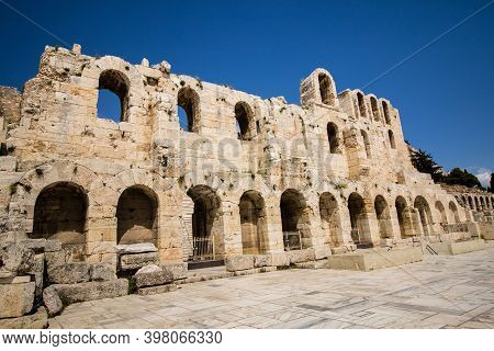 Entrance To The Theatre Of Dionysus Located Below The Acropolis In Athens, Greece, With Clear Blue S