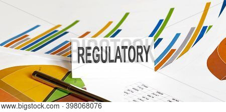 Regulatory Text On Paper On The Chart Background With Pen