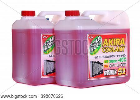 Novyy Urengoy, Russia - November 28, 2020: Bottles Of The Kyk Akira Coolant Isolated Over White Back