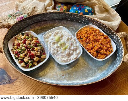 Traditional Appetizer Bulgur Or Bulghur Kisir, Celery Salad And Chickpea Lentil Salad. Turkish Greek