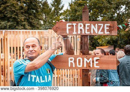 Moscow, Russia, July 13, 2019: A Smiling Man In A Blue T-shirt Stands At A Pillar With Directions In